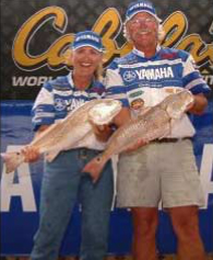 Fisherman and Woman with 2 big Redfish