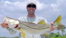 Large Snook and Fisherman